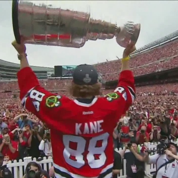 PATRICK KANE HOLDING UP CUP_161372