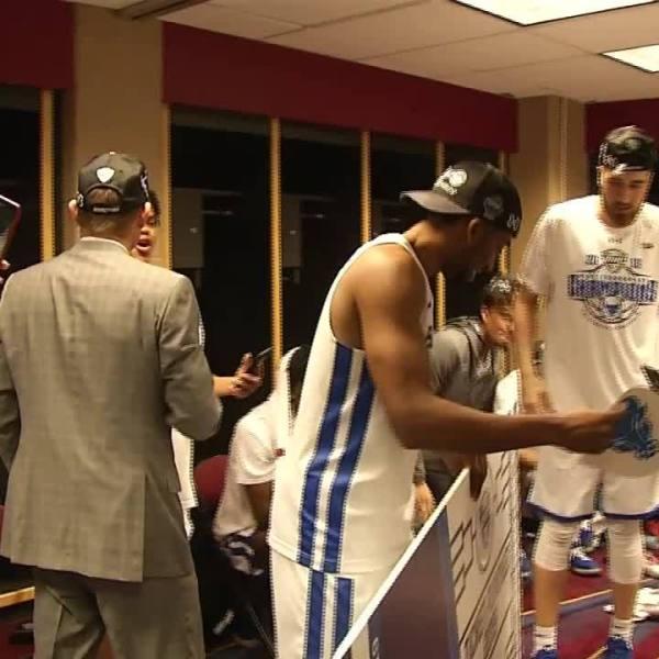 UB men championship locker room celebration
