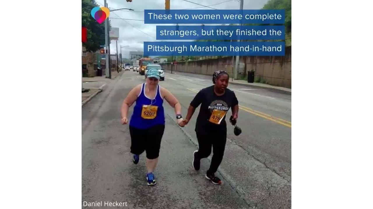 Pittsburgh Marathon runners cross the line hand-in-hand