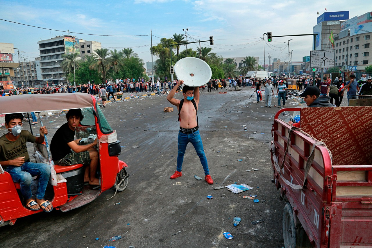 iraqi protesters hold baghdad square after night of clashes