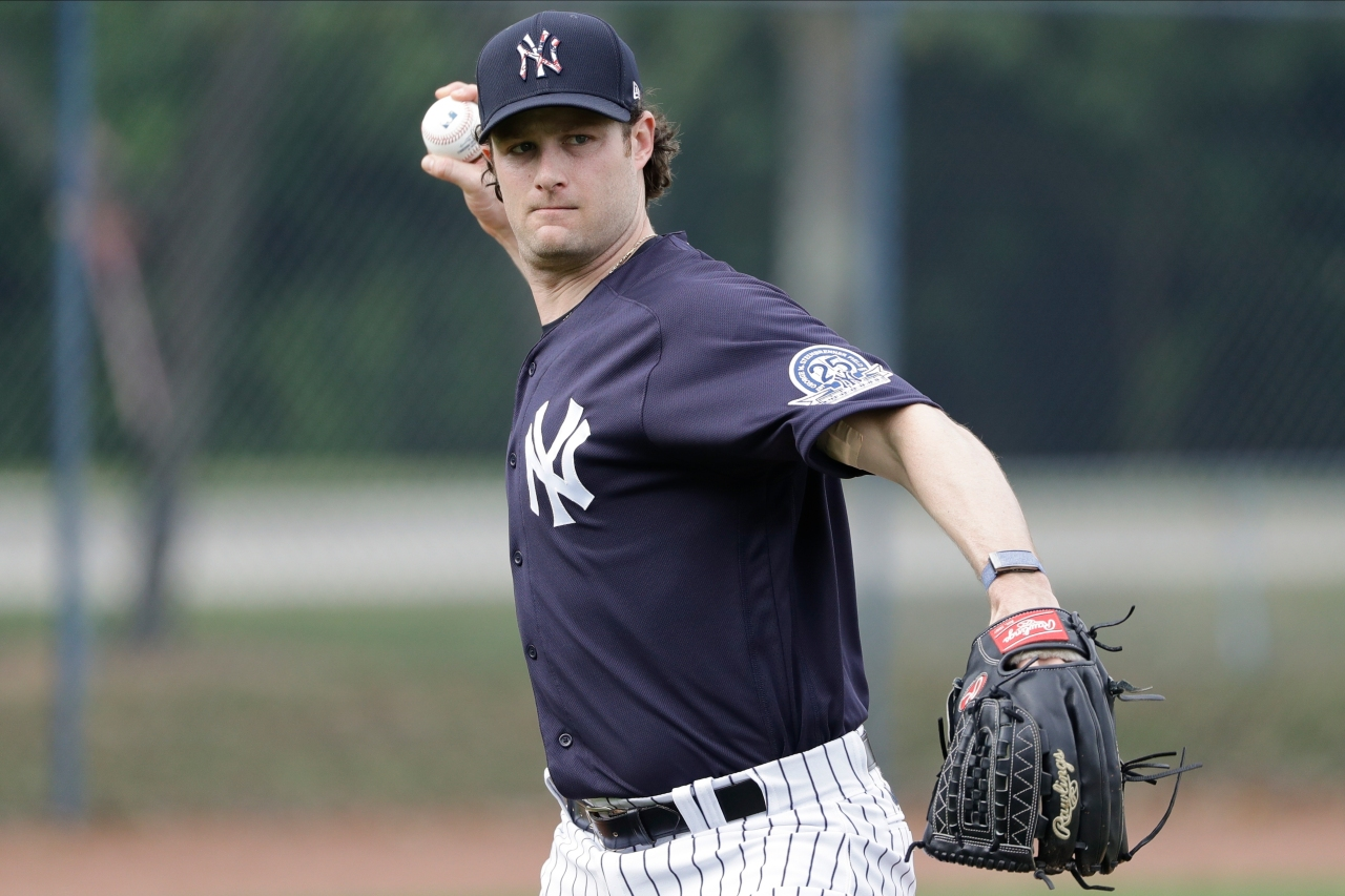 cole starts yankees tenure with questions about astros
